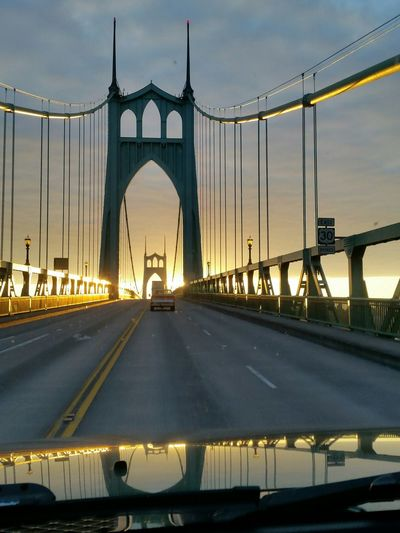 St John Bridge Against Cloudy Sky Seen From Car Windshield During Sunset