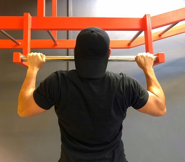 A man doing pull-ups in a fitness gym. Pull-Up Pull Ups Pullups Gym #aesthetics #physique #bodybuilder #bodybuilding #fitness #intermitentfasting #instafit #instamood #instagood #instagramhub #instagramfitness #musclephotos #muscleleague #jacked #beastmode #ripped #shredded #swole #swoldier #inspiration #fitness #a Gym Life Gym Time Gym Exercising Strength Rear View One Person Lifestyles Real People Men Gym Sport Challenge One Man Only Outdoors Young Adult Sportsman Day Adult People