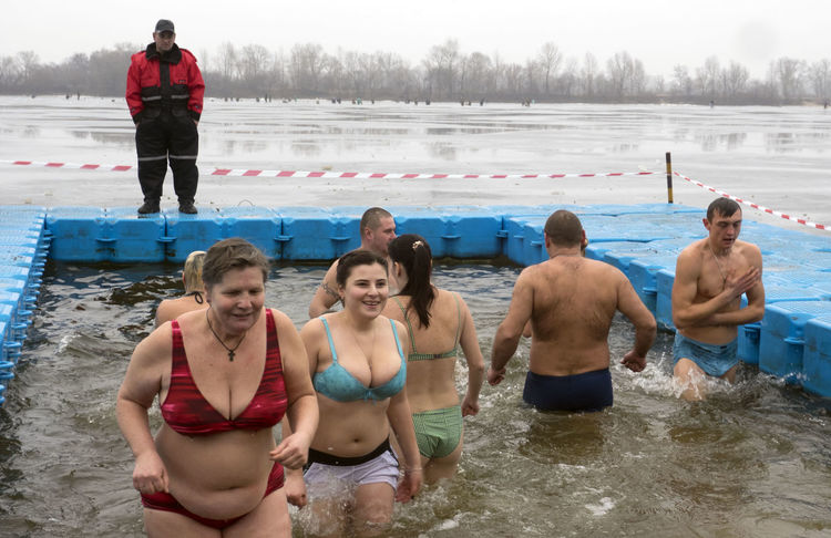 Great Christian holiday Epiphany on the banks of the Dnieper Banks Bonding Christian Cold Day Dnieper Epiphany Friendship Girls Great Holiday Leisure Activity Lifestyles Men Nature People And Places Person Religion River Standing Togetherness Water Weekend Activities Winter