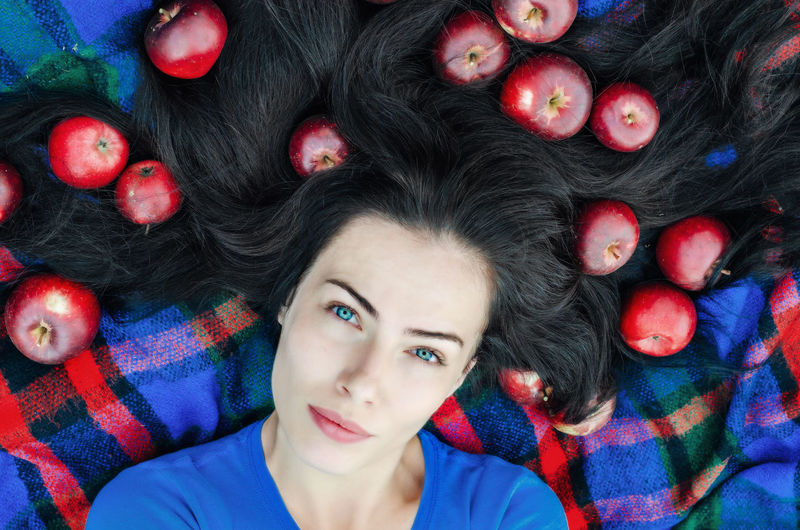 Cheerful girl lying on the nature on a checkered rug with red apples in black hair. Rest on nature. Healthy life. Relaxed state. Pleasant pastime. Eva style Girl Brunette Woman Apple Garden Portrait Of A Woman Nature Hair Blackhair Summer Love Sexygirl Attractive Pretty Lies Woman Health Portrait Headshot Looking At Camera Young Adult Lying Down Multi Colored One Person Indoors  Young Women Women Lying On Back Beautiful Woman Beauty Directly Above Front View High Angle View Adult Body Part Hairstyle Contemplation Human Face