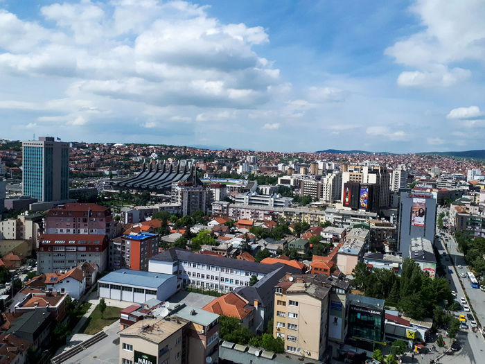 Kosovo Travel Destinations Summer Freshness Pollution Warning City Cityscape Urban Skyline Skyscraper Illuminated Modern Sky Architecture Building Exterior Cloud - Sky Residential District Housing Settlement TOWNSCAPE Settlement Office Building Aerial View Crowded Urban Scene Town Tiled Roof  Roof Residential  Rooftop Residential Building