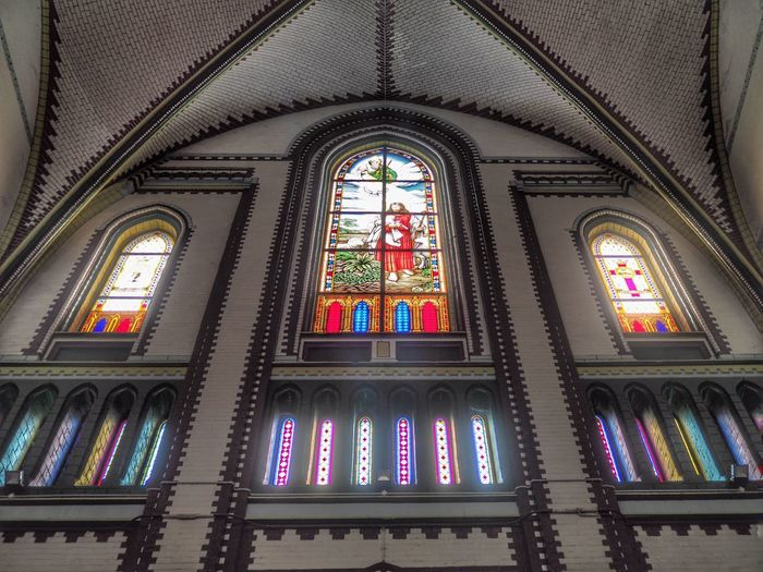 Low angle view of stained glass window in building
