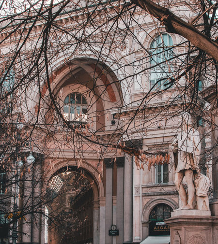 Milan Milano Arch Architecture Art And Craft Bare Tree Building Building Exterior Built Structure Day History Human Representation Low Angle View Milanocity No People Outdoors Plant Religion Representation Sculpture Spirituality Statue The Past Tree