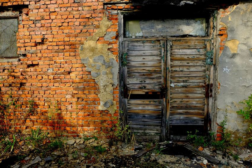 Walk forgotten streets of my city. Abandon_seekers Abandoned Abandoned Buildings Abandoned Places Architecture Bad Condition Best Eyeem Edits Best EyeEm Shot Brick Wall Building Exterior Built Structure Closed Damaged Day Deterioration Door From My Point Of View FUJIFILM X-T10 House Obsolete Old Wall - Building Feature Wasiak Weathered Wood - Material