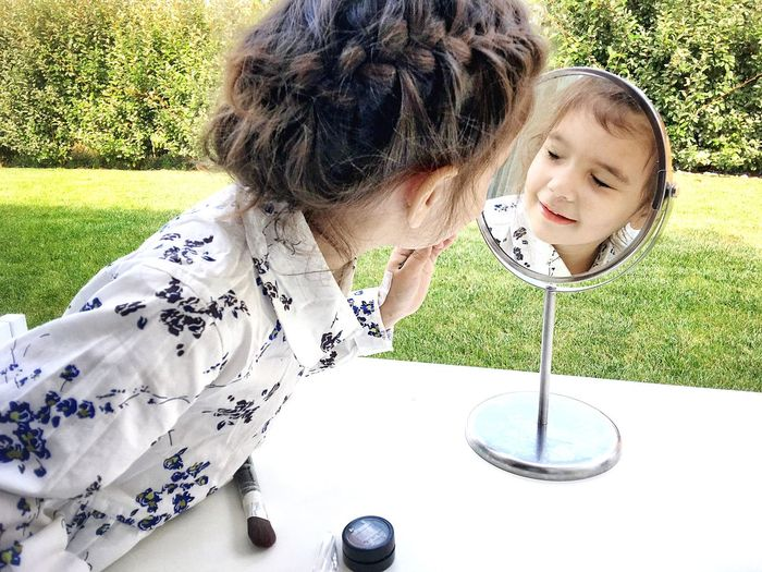 And she discovered make up little lady excited child make up time Exploring Sty Makeup Lover Girly Fillette Making Memories Little Lady  Excited Child Make Up Time Childhood Child Casual Clothing Day Girls Leisure Activity Sitting Grass Children Only Outdoors Smiling