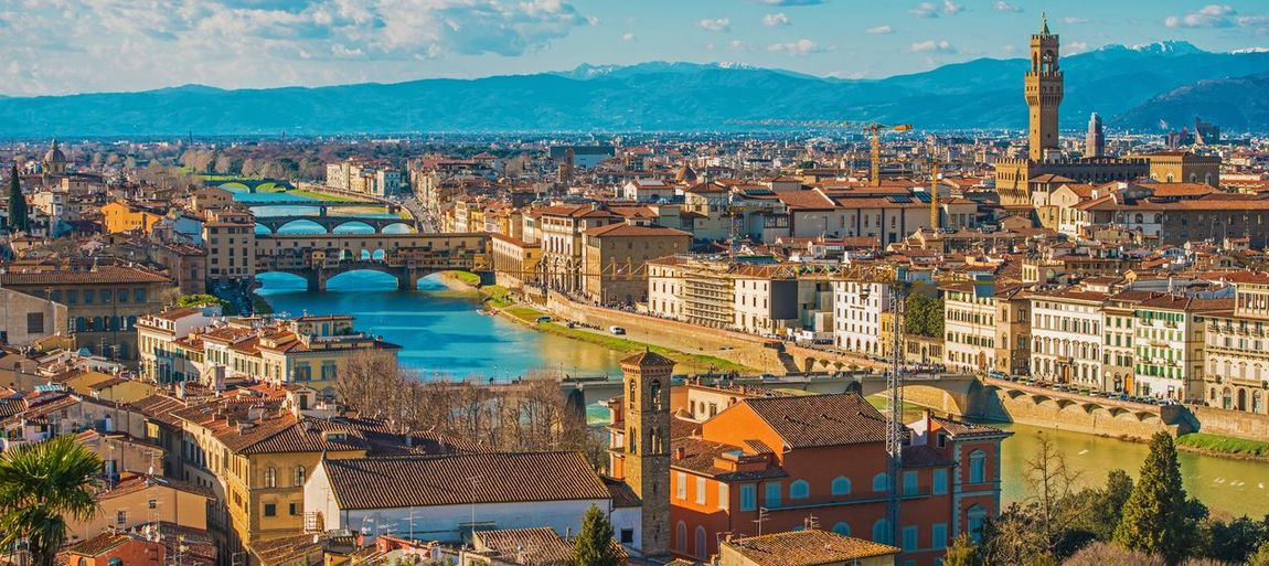 Florence Tuscany Italy. Sunny Summer Day Cityscape Panorama. Florence Italy Italian Europe Urban Skyline River Architecture Building Exterior Built Structure City High Angle View Cityscape Building Residential District Water Crowded Nature Day Crowd Travel Destinations Tourism Travel Sky Outdoors TOWNSCAPE
