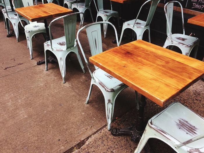 High angle view of empty chairs and table in restaurant