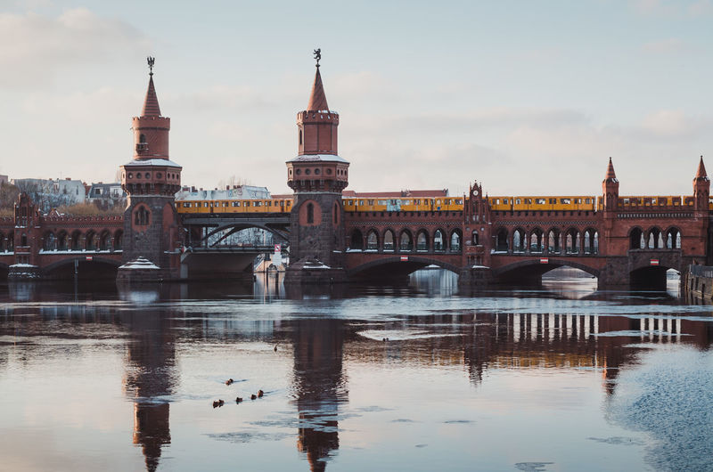 Oberbaumbridge in Berlin during the winter season Architecture Berlin Bridge City Cityscape Connection Day Friedrichshain Ice On The Water Kreuzberg No People Oberbaumbridge Oberbaumbrücke Outdoors Reflection River Riverbank Sky Spree River Berlin Travel Destinations Water Waterfront Winter Winterscapes Wintertime
