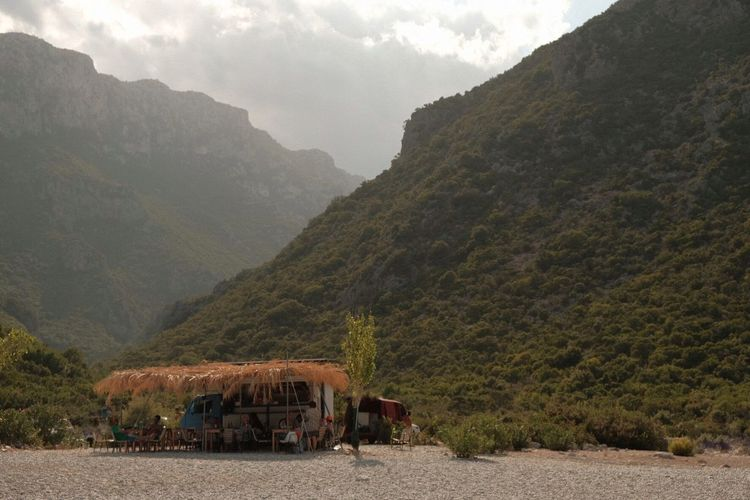 Food truck against mountains