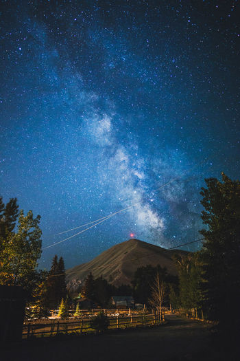Bright Milky Way above Della Mountain in Blaine County. Hailey, Idaho, USA. Astronomy Beauty In Nature Blue Galaxy Milky Way Mountain Nature Night No People Outdoors Plant Scenics - Nature Sky Space Star Star - Space Tranquil Scene Tranquility Tree