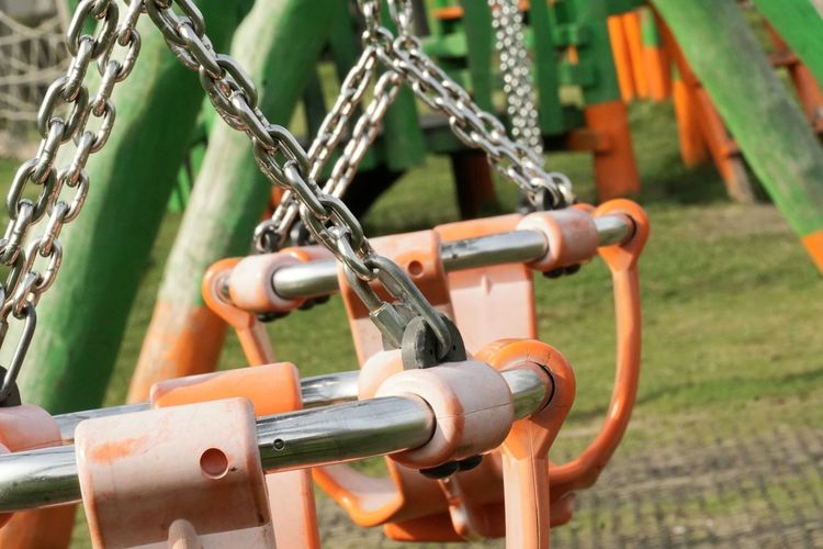 Close-up of chain on swing at park