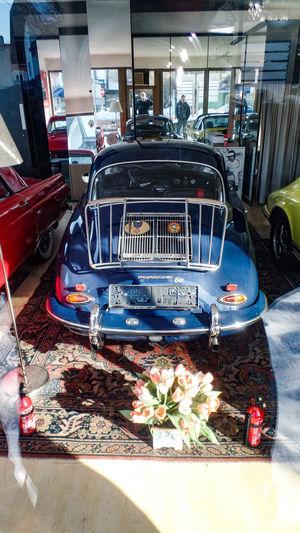 Car Mode Of Transportation Motor Vehicle Land Vehicle Transportation Retro Styled Day No People Indoors  Architecture Sunlight Stationary Vintage Car Nature Built Structure Garage City Plant Wheel