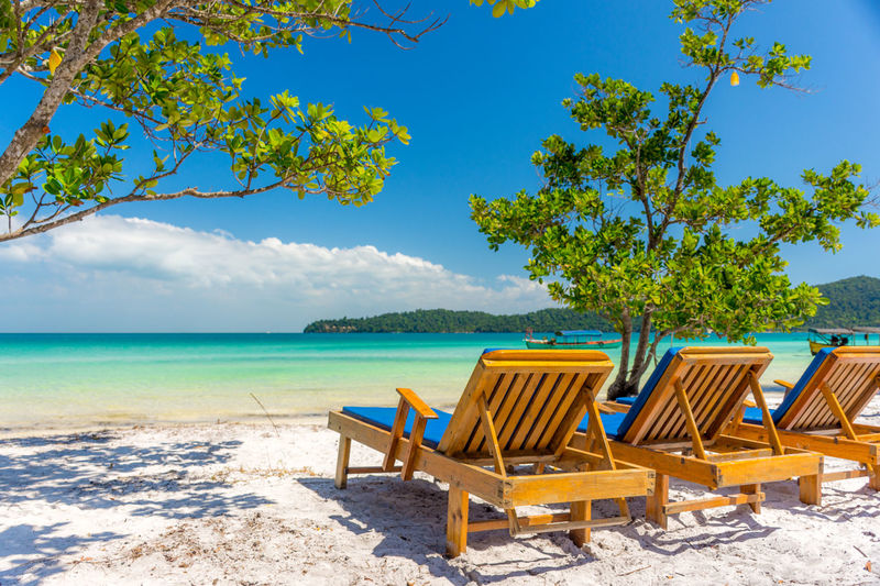 Sun loungers on the paradise beach of Koh Rong Sanloem. Beach Beauty Beauty In Nature Blue Chair Clear Sky Empty Horizon Over Water Idyllic Multi Colored Nature No People Relaxation Sand Sea Sky Summer Sunlight Sunny Tourism Tranquility Travel Travel Destinations Vacations Water