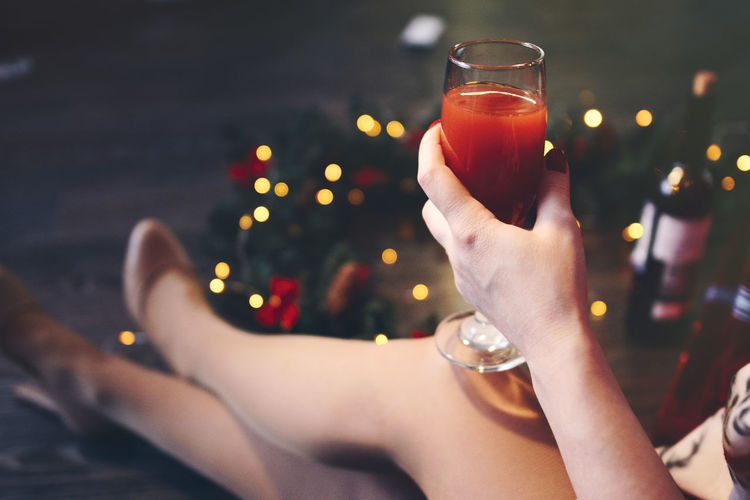 Girl in a dress at Christmas evening holding a glass of red wine Drink Refreshment Food And Drink Glass Hand Human Hand Real People Human Body Part Alcohol One Person Lifestyles Focus On Foreground Drinking Glass Adult Household Equipment Women Celebration Holding Leisure Activity Legs Woman International Women's Day 2019 My Best Photo