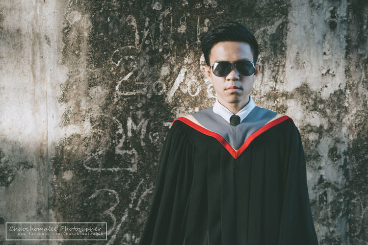 Adult Architecture Casual Clothing Fashion Front View Glasses Lifestyles Looking At Camera Men One Person Portrait Real People Standing Sunglasses Superhero Teenager Wall - Building Feature Young Adult Young Men