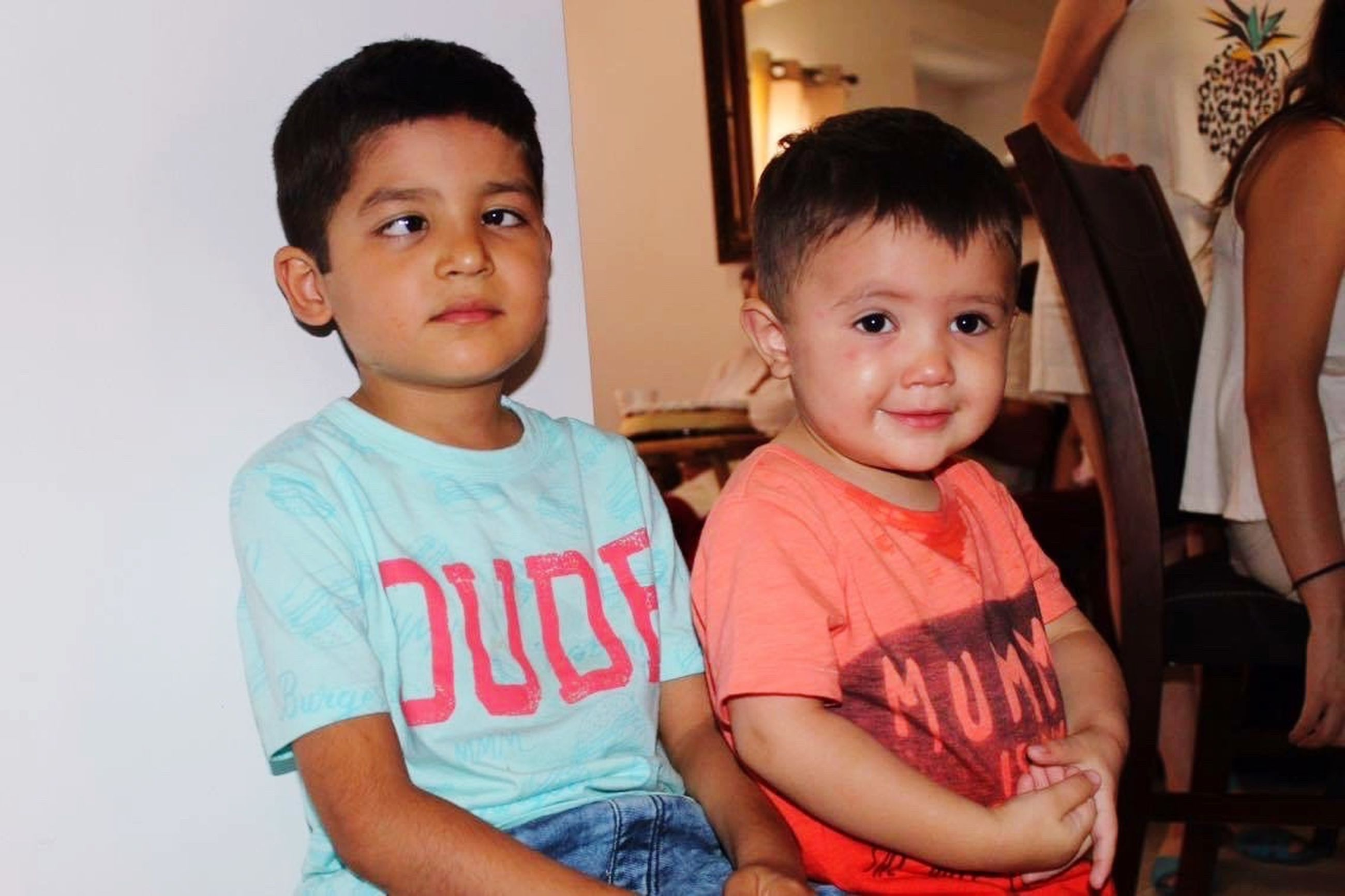 person, childhood, togetherness, lifestyles, bonding, indoors, elementary age, boys, casual clothing, leisure activity, portrait, smiling, happiness, looking at camera, love, front view, cute