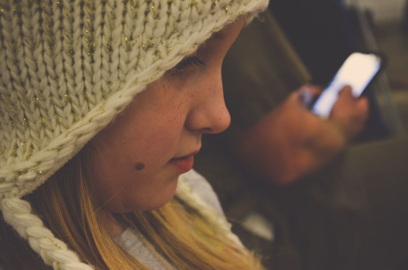 Close-up of girl wearing knit hat