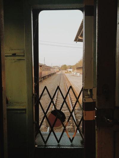 Railroad tracks seen through window