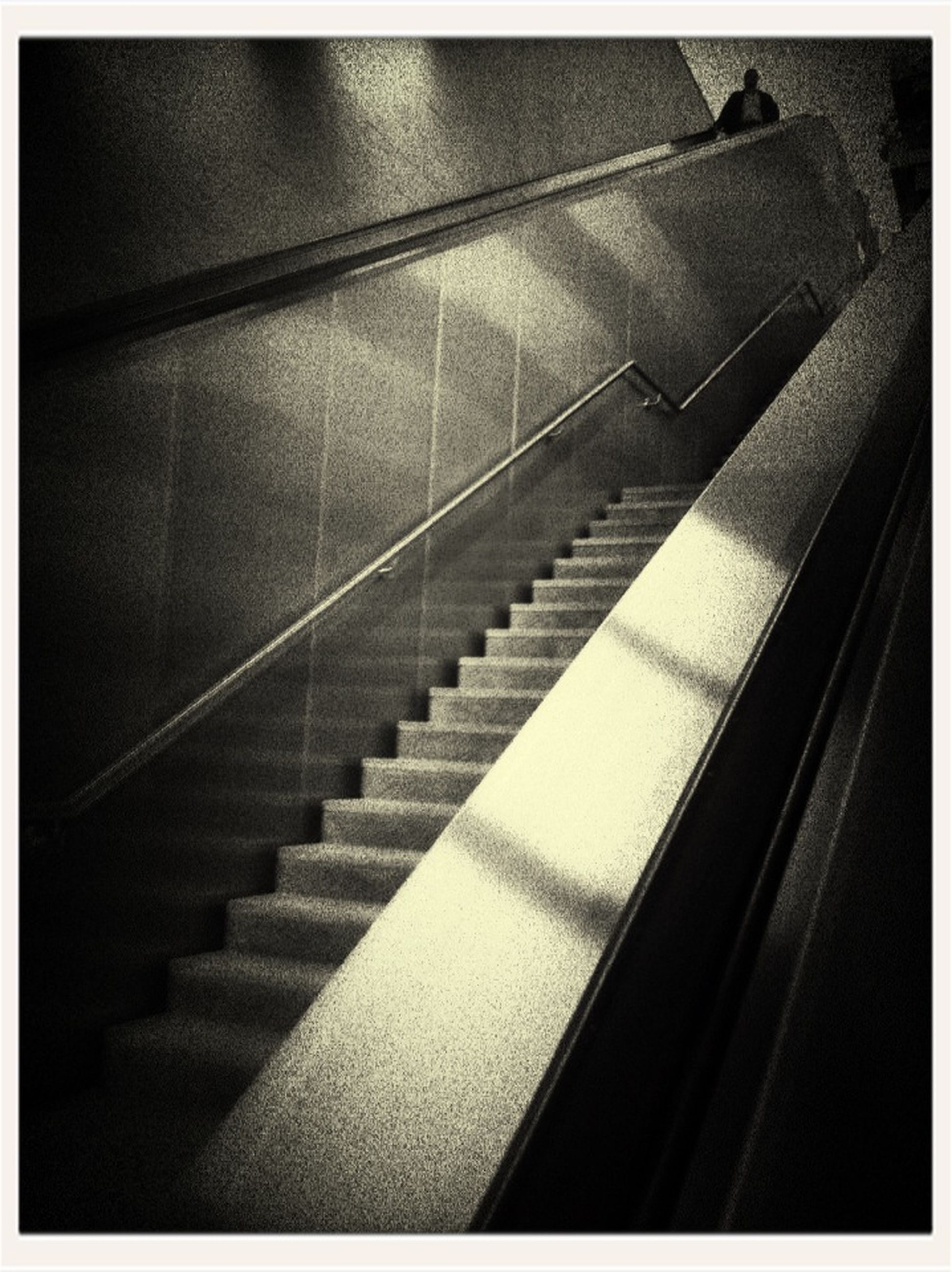 indoors, steps, steps and staircases, transfer print, staircase, escalator, railing, auto post production filter, high angle view, modern, built structure, architecture, low angle view, diminishing perspective, no people, the way forward, pattern, stairs, empty, technology