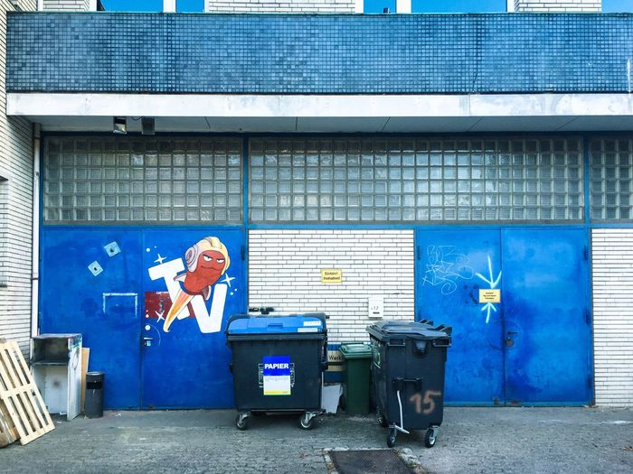 Hamburg backstage... Blue No People Architecture Blue Built Structure Building Exterior No People Day Patriotism City Wall - Building Feature Communication Garbage Bin Building Outdoors Wall Street Garage #urbanana: The Urban Playground