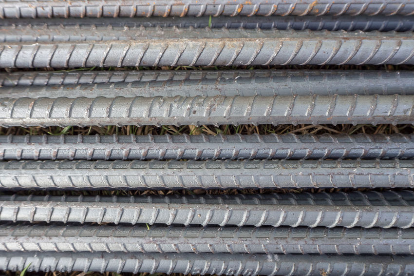 The construction steel bar image close up for background. Construction Aluminum Backgrounds Close-up Construction Industry Construction Steel Bar Construction Work Construction Worker Day Full Frame In A Row Industry Large Group Of Objects Metal No People Outdoors Pattern Repetition Rubber Stack Steel Bars