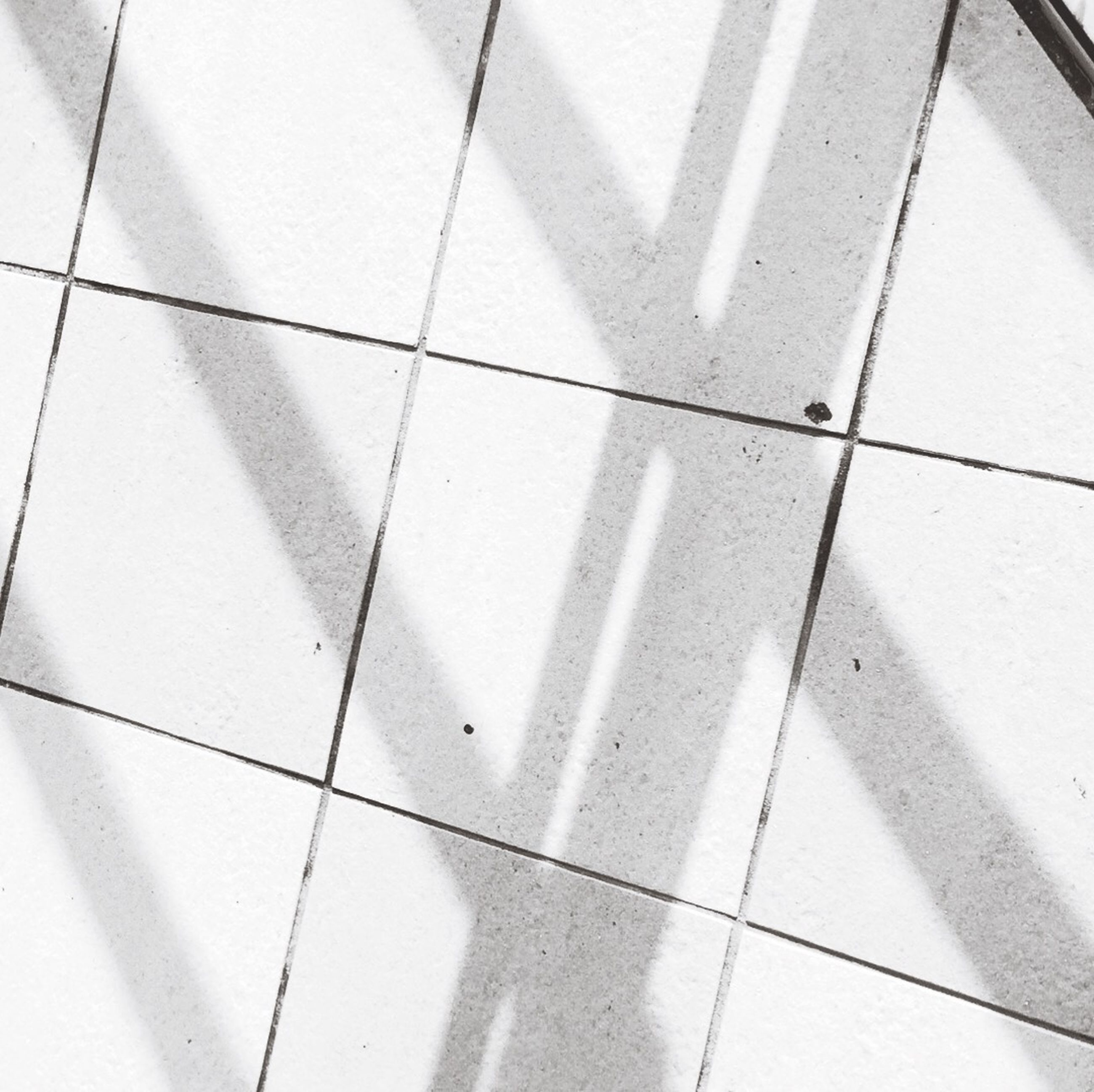 tiled floor, flooring, tile, indoors, high angle view, pattern, shadow, floor, low section, square shape, geometric shape, sunlight, white color, paving stone, reflection, full frame, day, backgrounds, footpath, person
