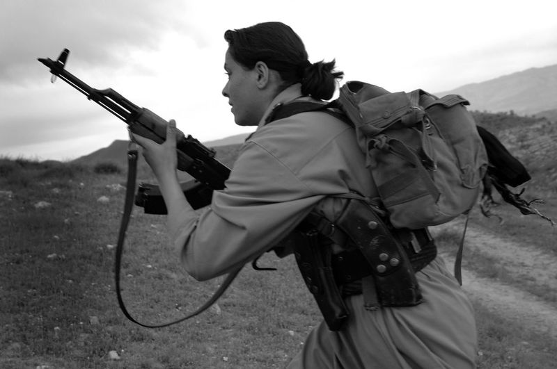 A female freedom fighter in Iraq EyeEmNewHere Woman Female Fighter Gun Kurdish One Person Peshmerga Rifle Weapon