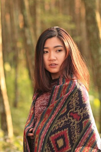 Adult Tenun Arts Culture And Entertainment Beautiful People Beautiful Woman Beauty Brown Hair Confidence  Fashion Front View Long Hair One Person One Young Woman Only Only Women Outdoors People Portrait Tenun Ikat Indonesia Tree Waist Up Young Adult Young Women EyeEm Selects EyeEm