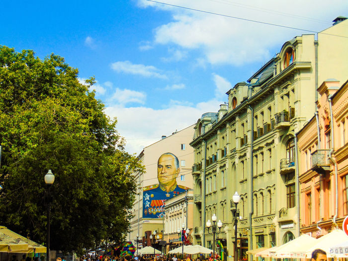 Architecture Street City Low Angle View Land Vehicle Transportation Day Town Outdoors City Life Cloud Building Exterior Tree Built Structure City Street Cityscapes Stone Cloudy Traveling ГраффитиМосквы Moscow Russia No People Creativity Graffiti