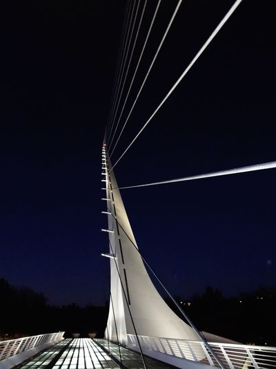Low angle view of bridge against sky at night