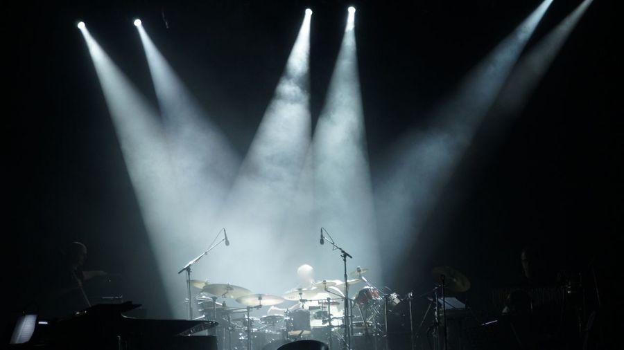 Spotlights on drums at concert