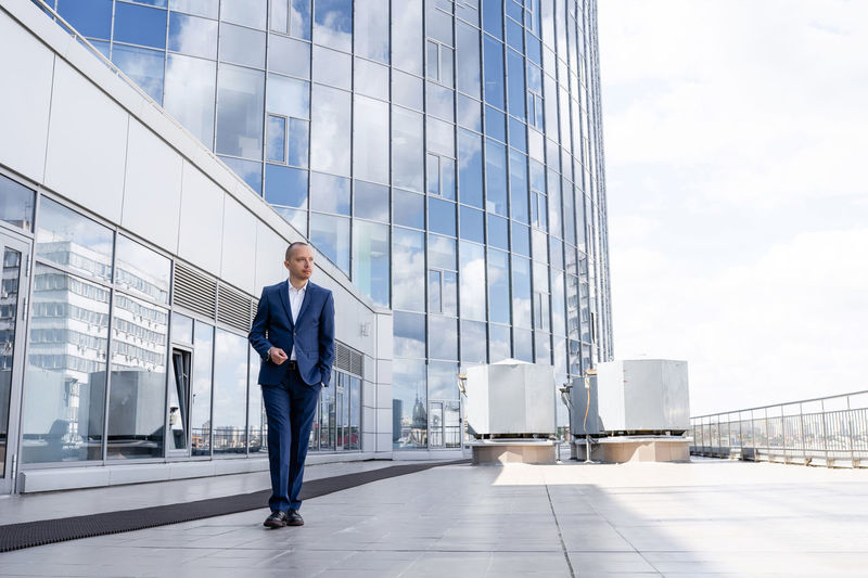 Full length of man walking in modern building