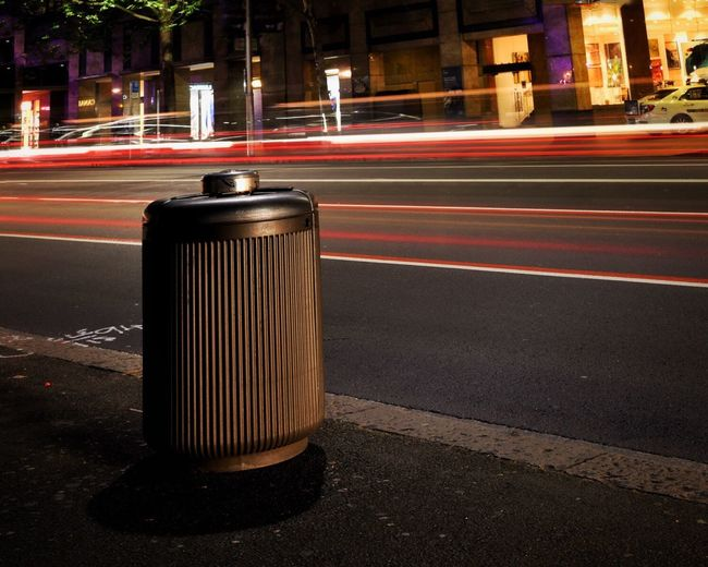 A bin's life on the fast lane. Night City Street City Street Road Outdoors Car Headlights No People Built Structure Ugly Subject Bin Street Bin Bin View EyeEmNewHere Canon EOS 750D Edited With Snapseed