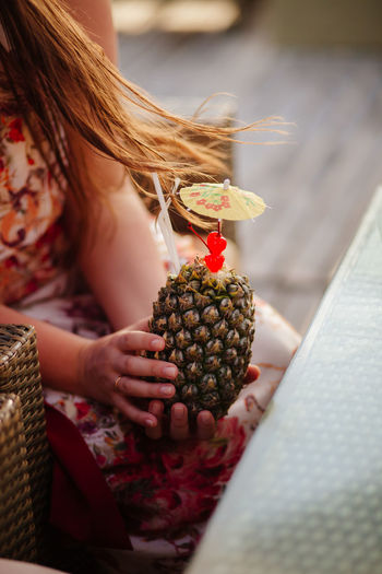 Close-up of woman holding fruit