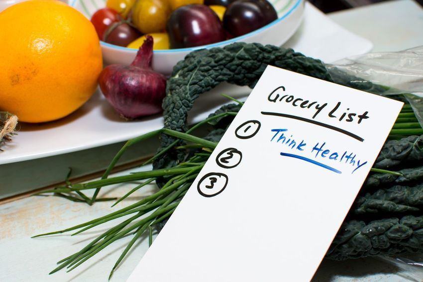 Making a healthy grocery list New Years resolutions for healthy lifestyle, diet and eating Shopping List Shopping Home Interior Kitchen Healthy Lifestyle Healthy Eating Conceptual Grocery Shopping Groceries List Orange Kale Food Healthy Eating Fruit Food And Drink Wellbeing Vegetable Freshness Still Life Indoors  Text No People Close-up Table High Angle View Herb Plant Tomato Communication