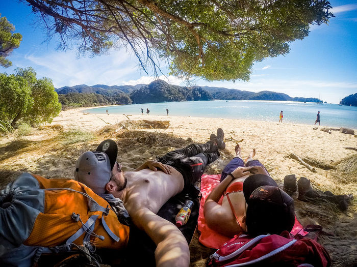 couple lying under a three at the beach after a hike in the abel tasman national park Abel Tasman Nationalpark Couple Hiking Beach Beauty In Nature Blue Water Day Group Of People Land Leisure Activity Lifestyles Lying Down Mountain Nature New Zealand Outdoors People Plant Real People Relaxation Scenics - Nature Selfie Sky Tree Water The Great Outdoors - 2018 EyeEm Awards Summer Sports