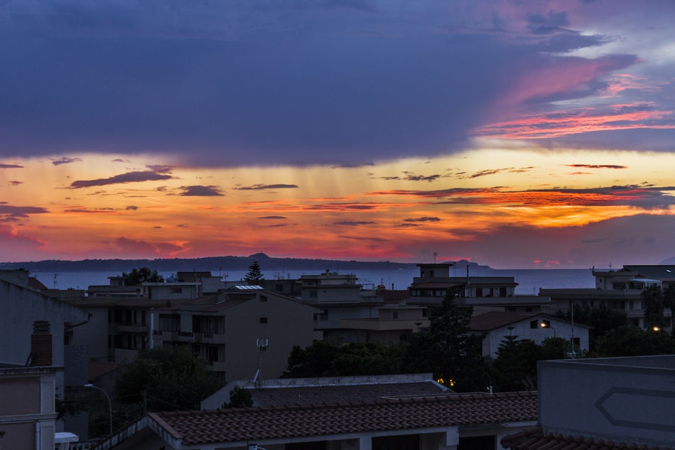 Milazzo Nuvole Sicily Tramonto Abitazioni Architecture Beauty In Nature Building Exterior Built Structure Cloud - Sky Dramatic Sky Ferragosto 2018 Isole Eolie Italy Maltempo Mar Mediterráneo Mar Tirreno Orange Color Penisola Residential District Romantic Sky Rometta Marea Sky Sunset Tranquility