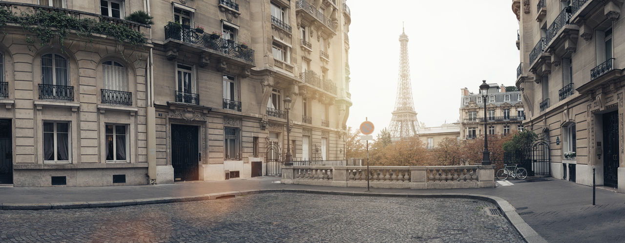 Avenue de Camoens in Paris with view to the eiffel tower Autumn Avenue De Camoens Eiffel Tower Old Town Panorama Panoramic View Paris Sunlight Travel Architecture Building Building Exterior Built Structure City City Life Eiffeltower Empty Europe Nature No People Paris France Road Street Sunflare Travel Destinations