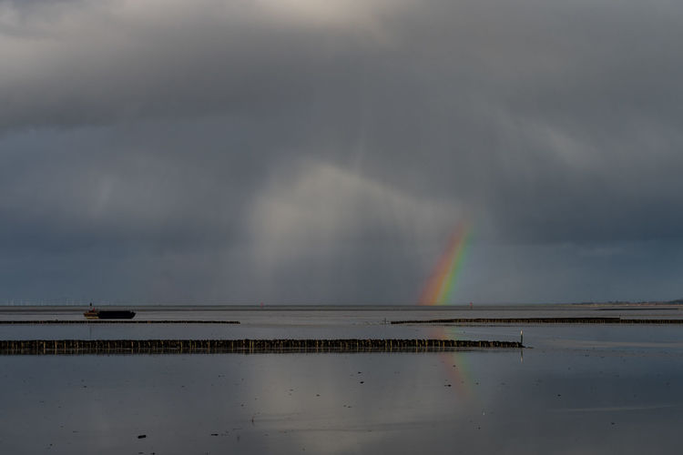 Nordsee & Regenbogen Architecture Beauty In Nature Cloud - Sky Day Nature No People Outdoors Rainbow Scenics Sky Water