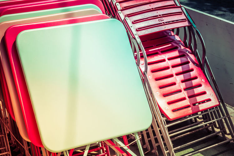 Cafe Close-up Closed Caffee Day Folded Chairs Folded Tables High Angle View Illuminated No People Outdoors Red Red Green Color Street Photography Summer