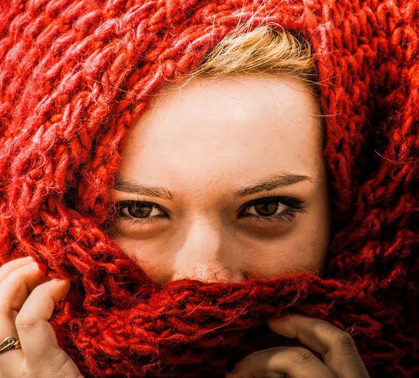 Full frame portrait of woman wearing red headscarf