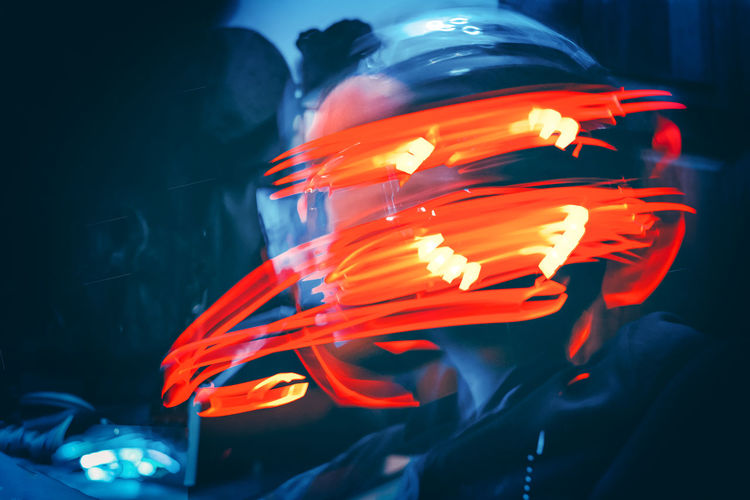 Digital composite image of boy amidst illuminated light