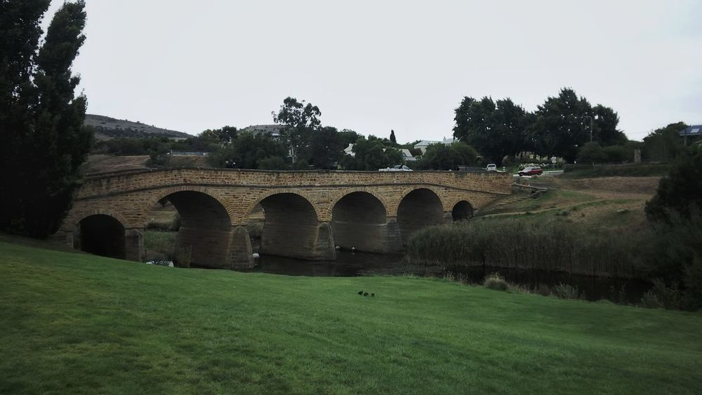 Arch Bridge - Man Made Structure Grass Architecture Tree Outdoors Green Color Built Structure Landscape Day No People Water Rural Scene Nature Sky Tasmania Richmond EyeEmNewHere