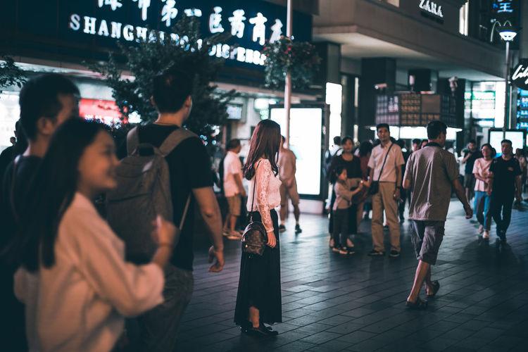 Group of people walking in city