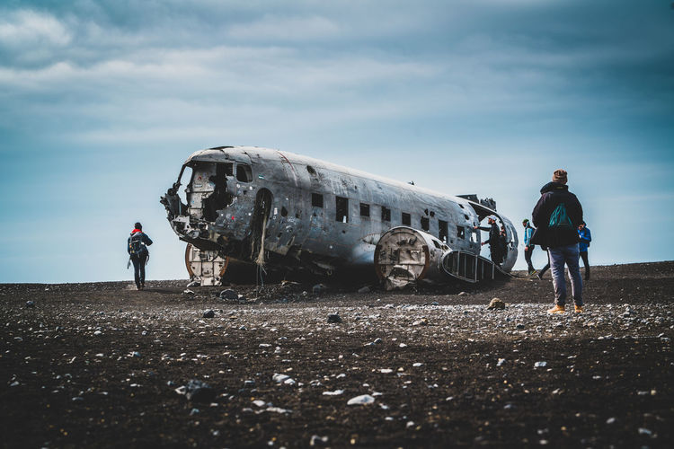 People standing on abandoned airplane
