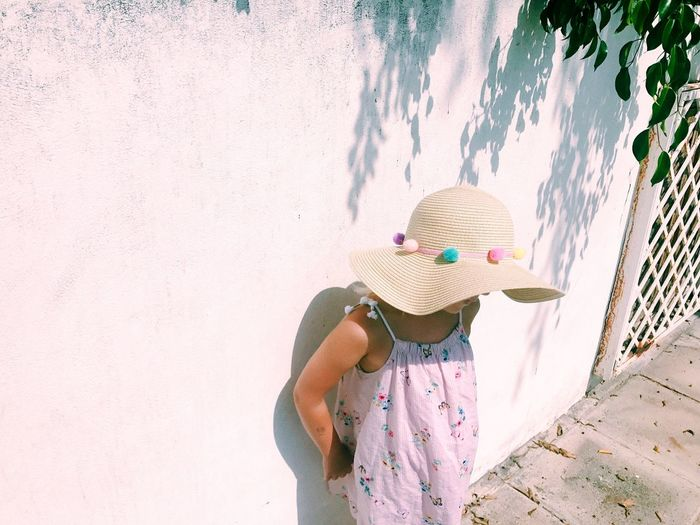 One Person Women Childhood Lifestyles Real People Clothing Leisure Activity Child Day Sunlight Females Plant Outdoors Standing Waist Up Girls Unrecognizable Person Hat Nature