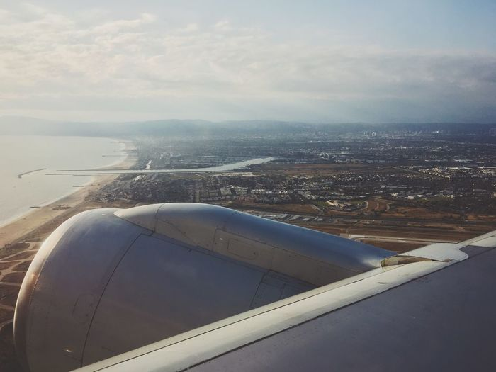Cropped image of airplane over sea
