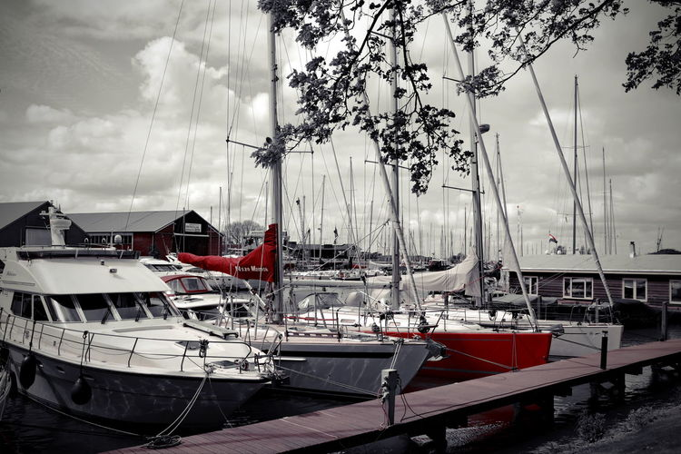 Boat Cloud - Sky Eye4photography  EyeEm EyeEm Best Edits EyeEm Gallery Harbor Leisure Activity Marina Mode Of Transport Muiderslot Nederland No People Outdoor Photography Outdoors Red Resting Selective Color Side By Side Standing Still Still Life Transportation Waiting