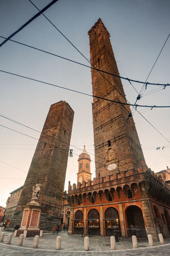 Bologna, Italy: the famous two towers seen from below Bologna Bologna Italy Italy Towers Torre Degli Asinelli Torre Garisenda Low Angle View Travel Destinations Building Exterior Architecture Built Structure Sky Tourism Travel Tall - High The Past Landmark