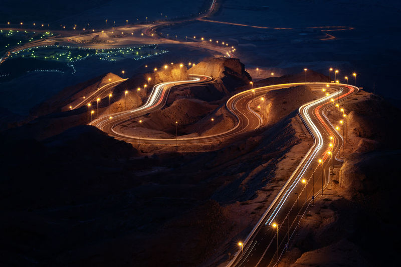 night road Al Ain Light Lines Travel Traveling UAE Curve High Angle View Highway Illuminated Long Exposure Motion Mountain Nature Night No People Road Speed Street Tourism Transportation The Great Outdoors - 2018 EyeEm Awards The Traveler - 2018 EyeEm Awards Summer Road Tripping HUAWEI Photo Award: After Dark